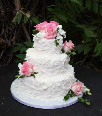 Coconut Wedding Cake with Fresh Flowers by Donna Joy